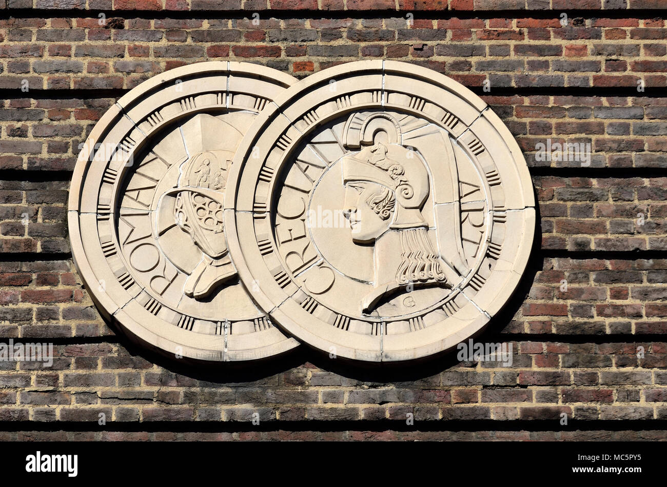 London, England, UK. Detail on wall of the Saville Theatre - Roman / Grecian art (1931: Gilbert Bayes) [some damage digitally repaired] Stock Photo