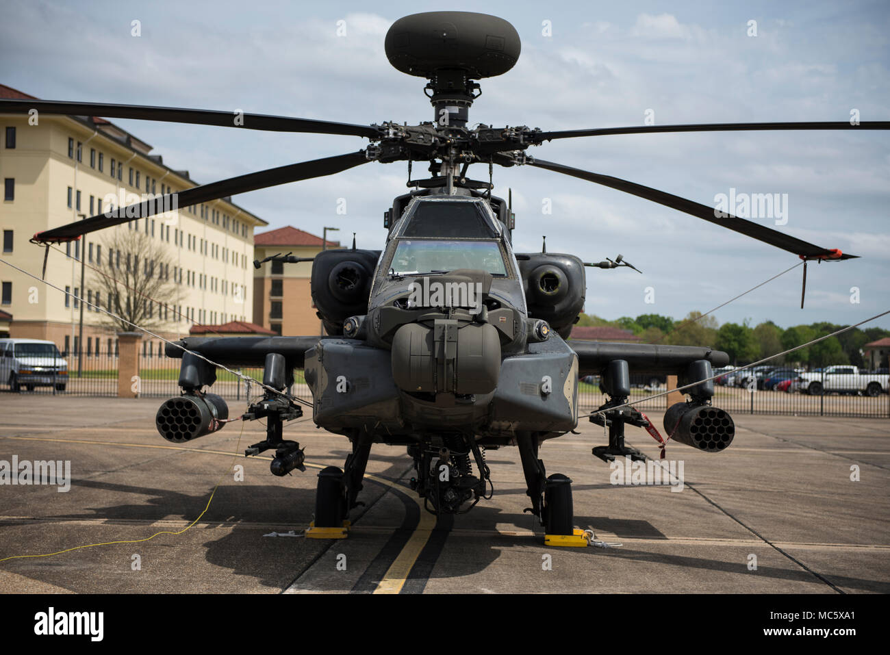 A Boeing AH-64 Apache helicopter sits on the Maxwell flightline March 27, 2018, on Maxwell Air Force Base, Alabama. The helicopters were grounded at Maxwell for four days because of bad weather. (U.S. Air Force photo by Airman 1st Class Charles Welty) - Stock Image