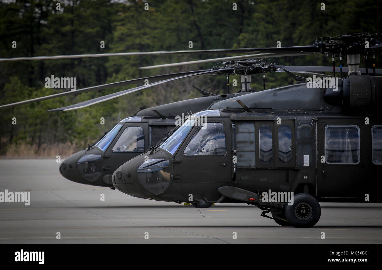 A New Jersey Army National Guard UH-60L Black Hawk helicopter from 1st Assault Helicopter Battalion, 150th Aviation Regiment lands after training over Joint Base McGuire-Dix-Lakehurst, N.J., April 11, 2018. (U.S. Air National Guard photo by Master Sgt. Matt Hecht) Stock Photo