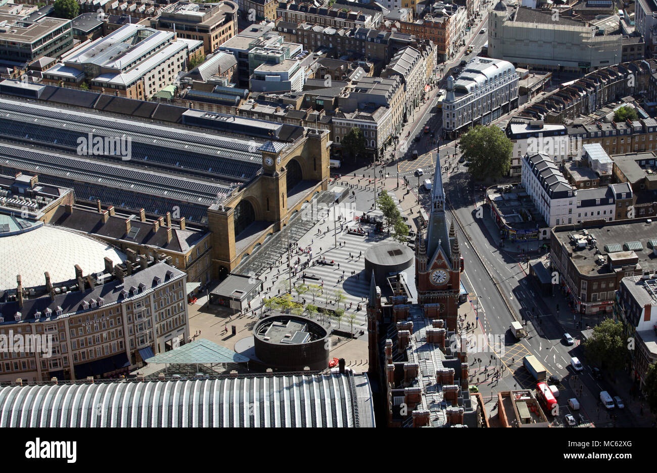 aerial view of commuters & people outside London St Pancras & Kings Cross Stations, London - Stock Image