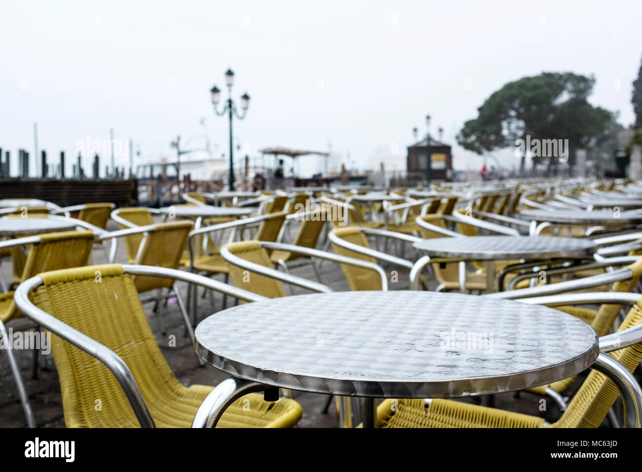 Abandoned chairs of a cafe on a rainy day in Venice, Italy, 2018 - Stock Image