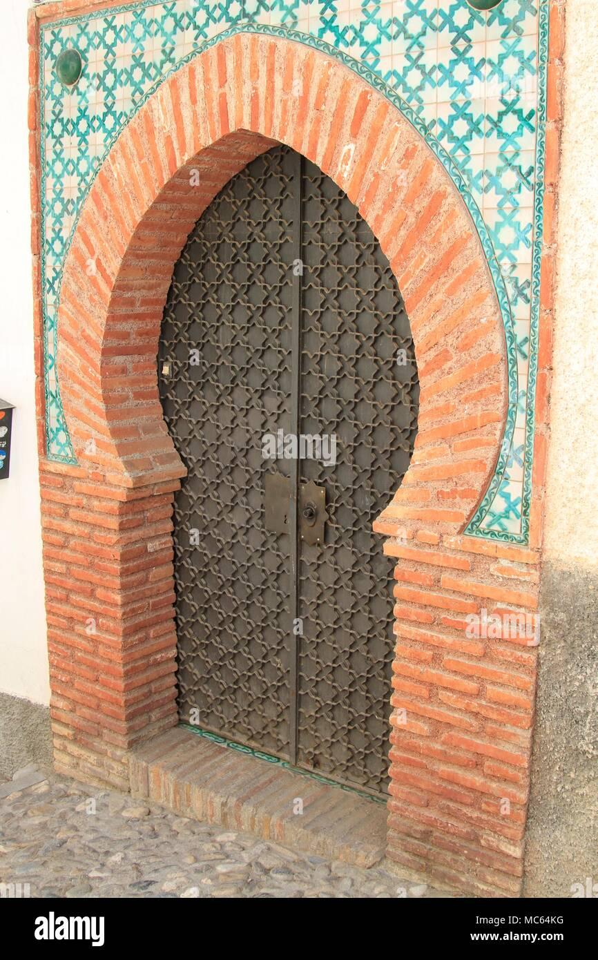 Keyhole arched doors of the Albaicin neighborhood, Granada, Spain - Stock Image