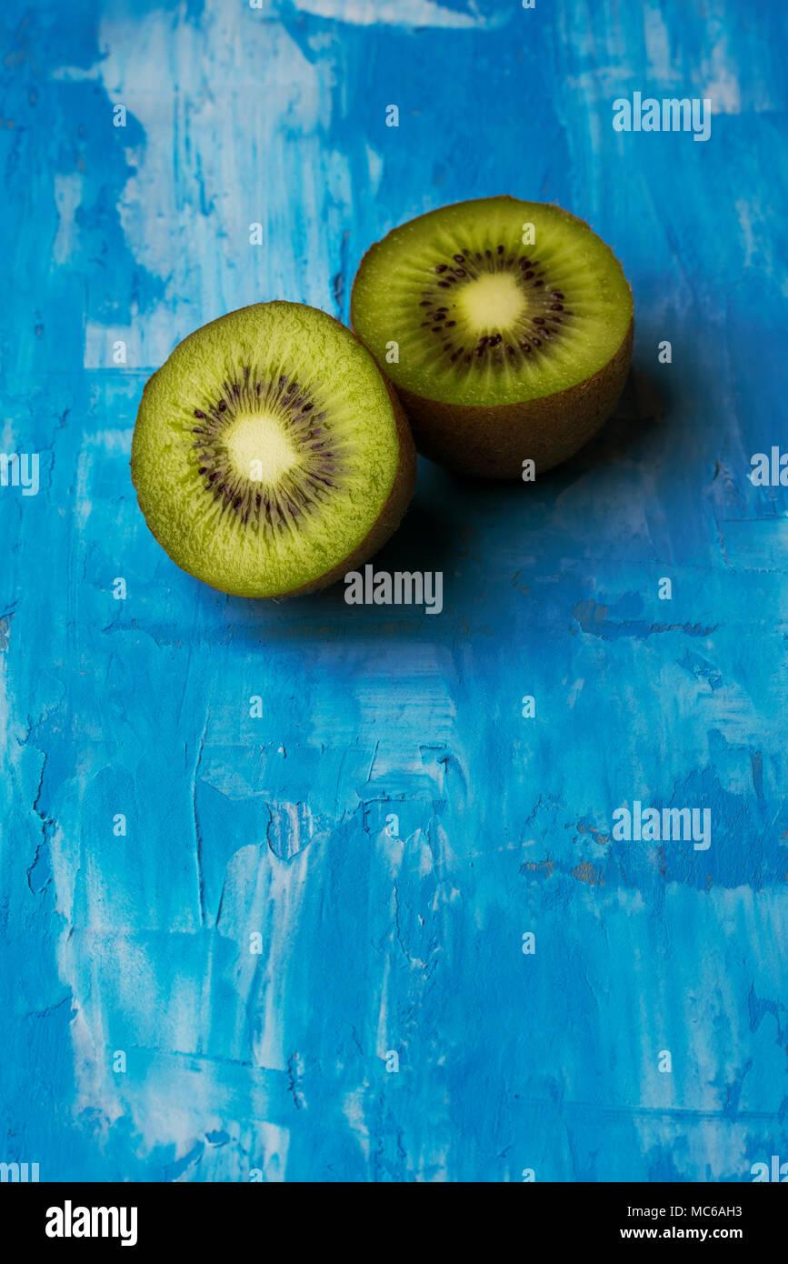 Kiwis in blue background textured - Stock Image