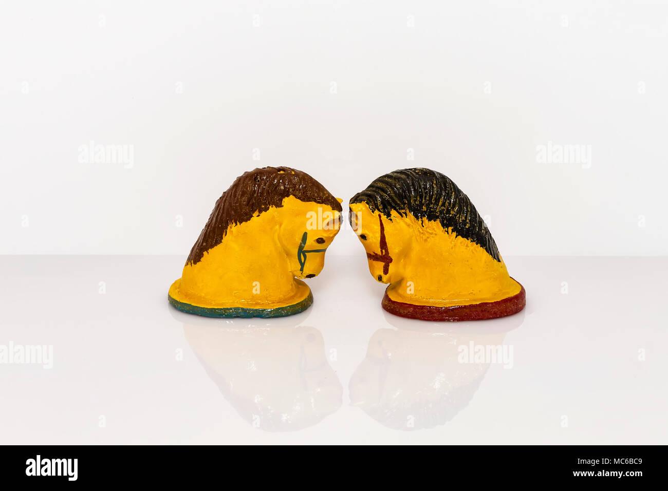 plaster cast replica of a horses head salt and pepper shaker set - Stock Image