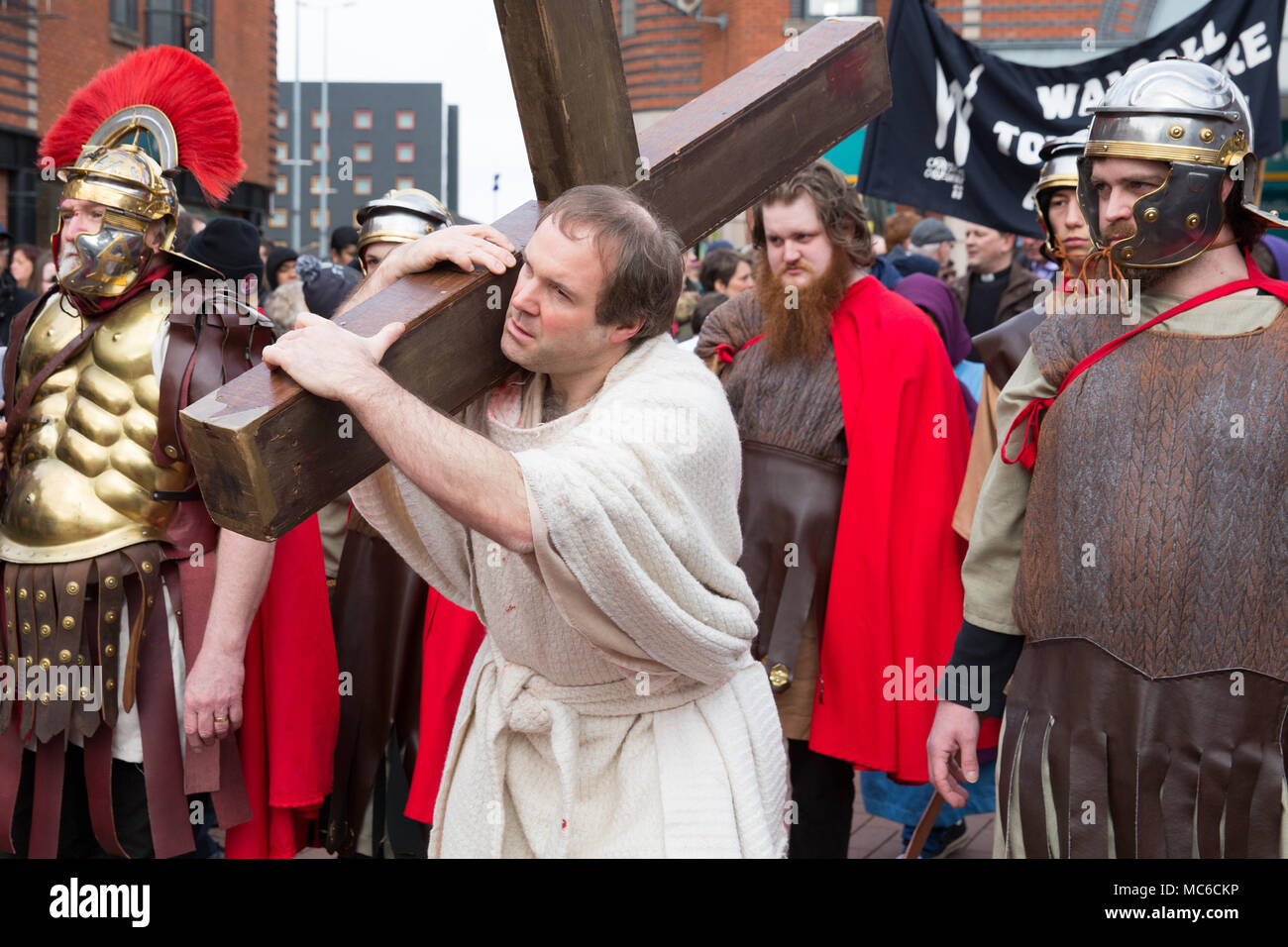 The annual Good Friday Walk of Witness taking place in Walsall Town Centre. Actors play the part of telling the story of the death of Jesus. - Stock Image