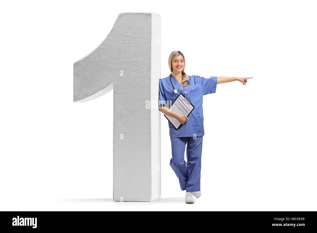 Full length portrait of a female doctor leaning against a number one figure and pointing isolated on white background Stock Photo