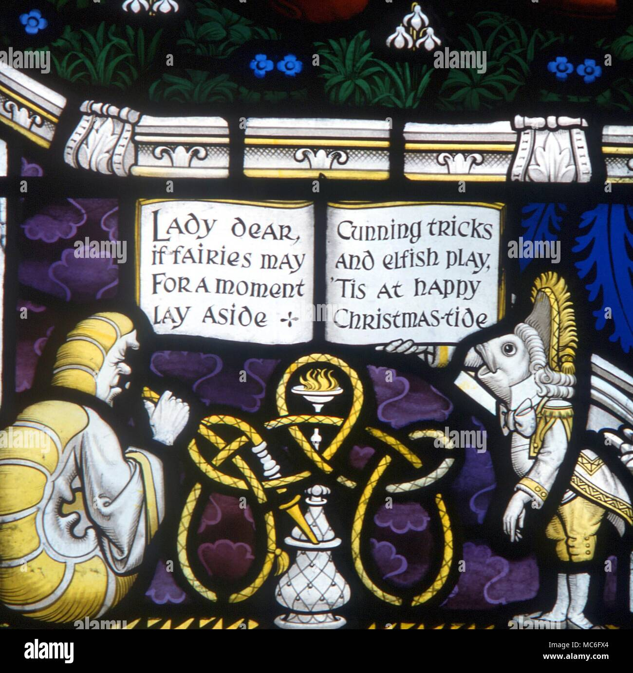 Dormouse, Hare and Mad Hatter - detail of the Lewis Carroll memorial window at Daresbury - Stock Image