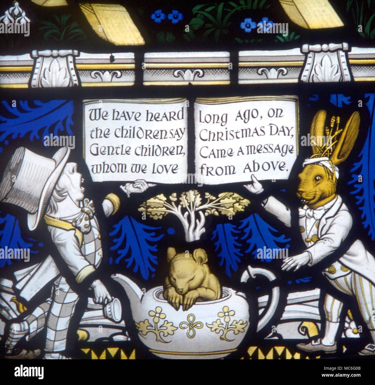 ANIMALS - Detail of the March Hare, the Mad Hatter and the Dormouse, on the Lewis Carroll memorial window at Daresbury Parish Church. Designed by Geoffrey Webb, and dedicated in 1934  Dormouse, Hare and Mad Hatter - detail of the Lewis Carroll memorial window at Daresbury - Stock Image