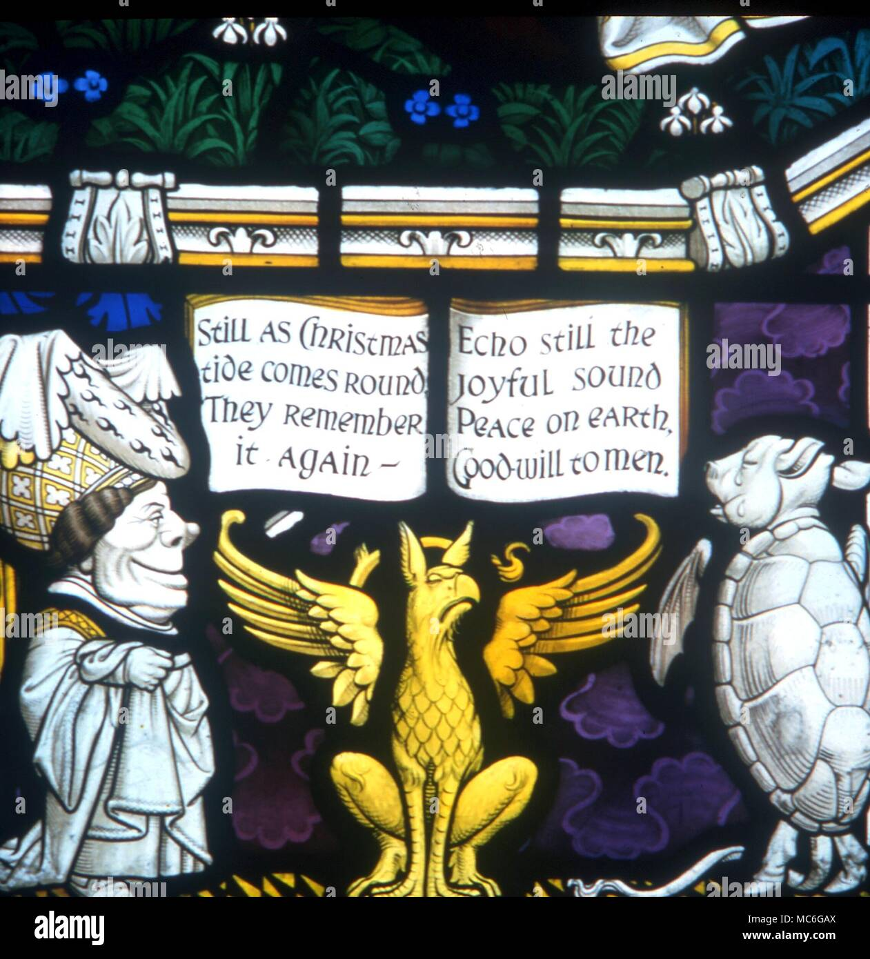ANIMALS Mock turtle and griffin.  Stained glass window (detail) from the Carroll Memorial Window, Daresbury parish church.  The Duchess is to the left  Griffin, with Mock Turtle and Queen, memorial stained glass windows to Lewis Carroll at Disbury - Stock Image