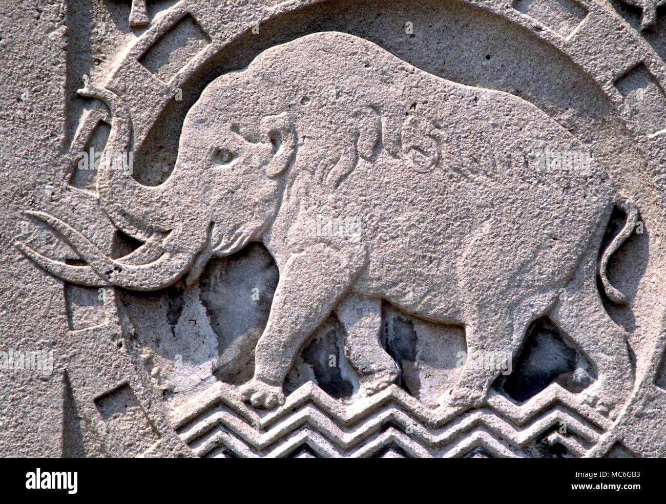 Animals mammoth relief carving of a mammoth on the facade of the