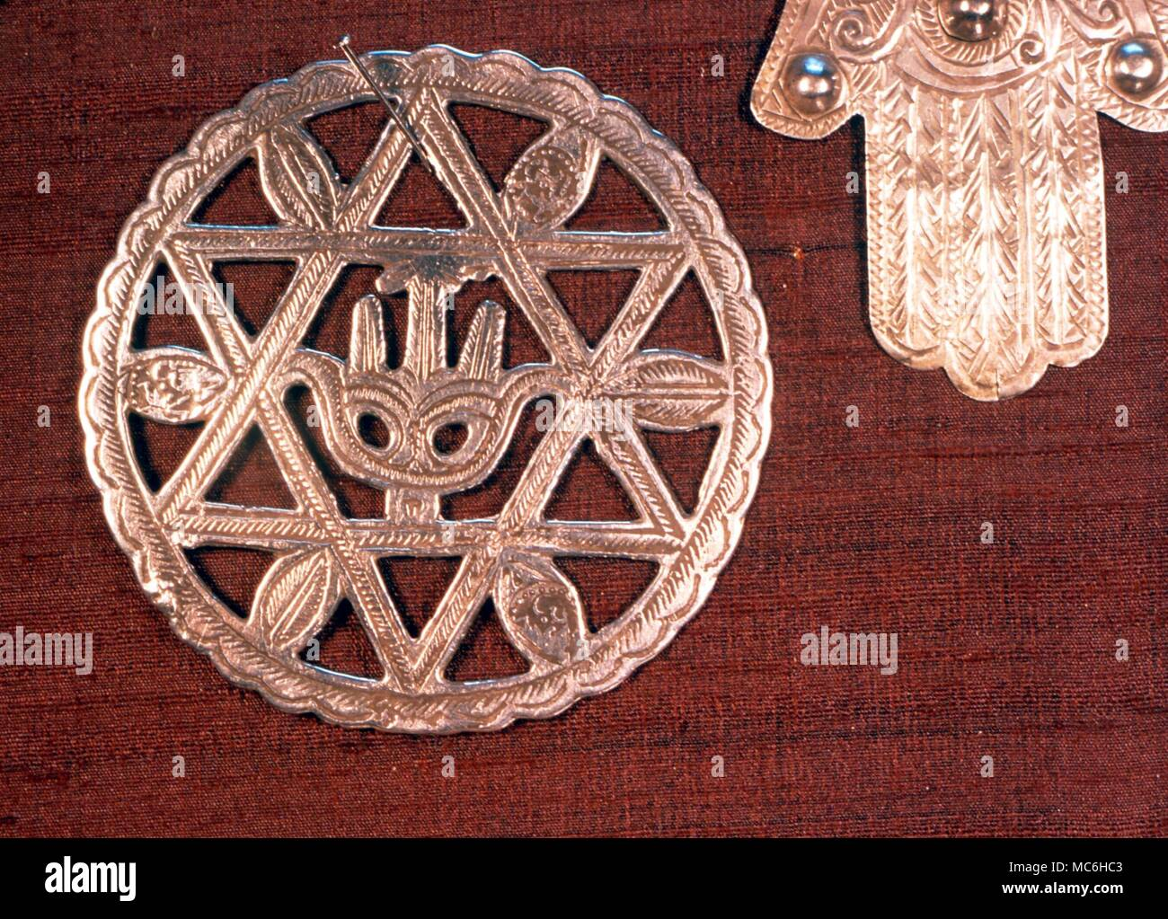 AMULETS - Pendant amulet, with central stylized 'hand of