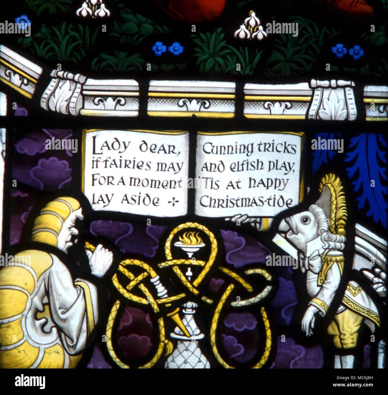 FAIRY STORIES - Caterpillar with hooker.  Detail from the stained glass window dedicated to Lewis Carroll, in which his fairytale characters appear.  Daresbury parish church - Stock Image