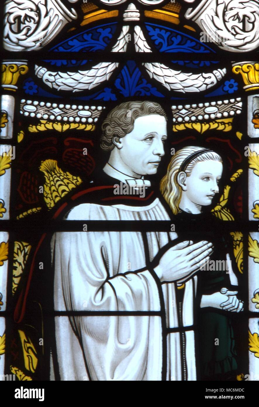 FAIRY TALES - LEWIS CARROLL.  The author Carrol with the young Alice.  Detail from the stained glass window dedicated to Lewis Carroll, in which his fairytale characters appear.  Daresbury parish church - Stock Image