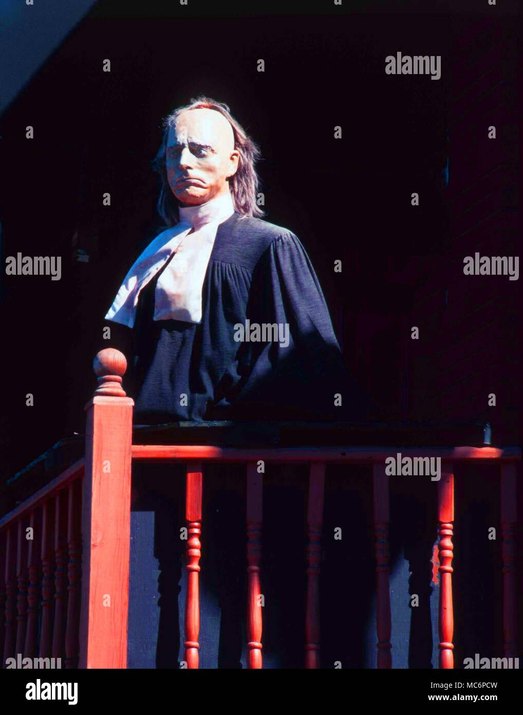 Wax-works model of a Judge who presided over the famous witch trials at Salem.   The figure s tands outside the popular Salem Wax Museum of Witches, in that town. - Stock Image