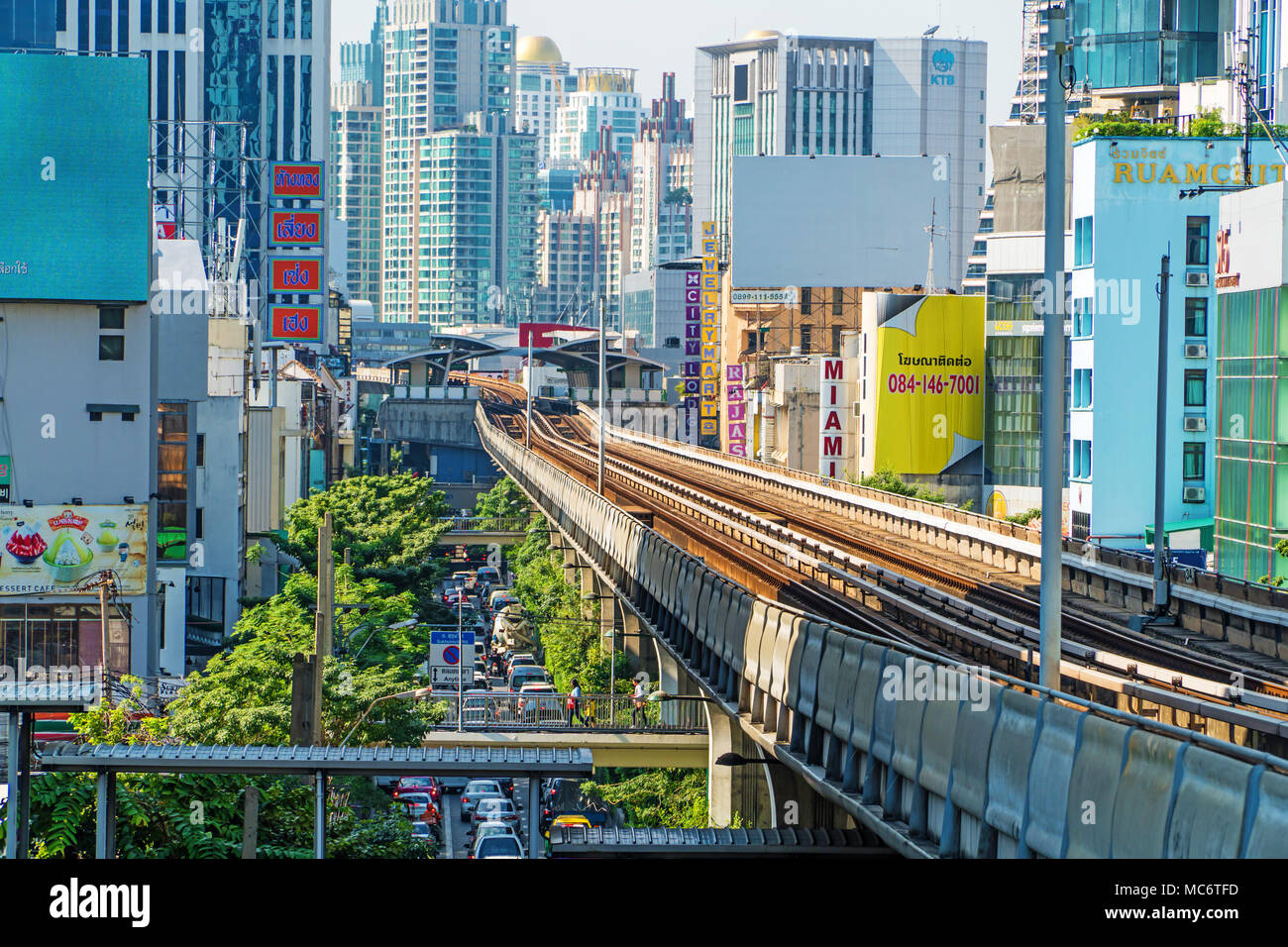 BANGKOK - JANUARY 19, 2017: Bangkok Cityscape, business district with high building and scy train railway at sunshine day on january 19, 2017 in Bangk - Stock Image