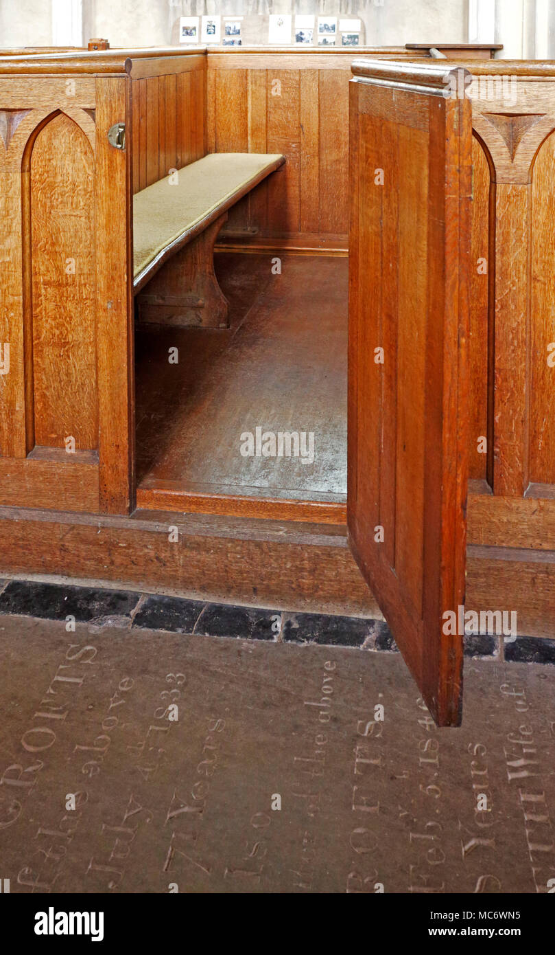 Detail of a wooden box pew in the parish church of St Mary the Virgin at Wiveton, Norfolk, England, United Kingdom, Europe. - Stock Image