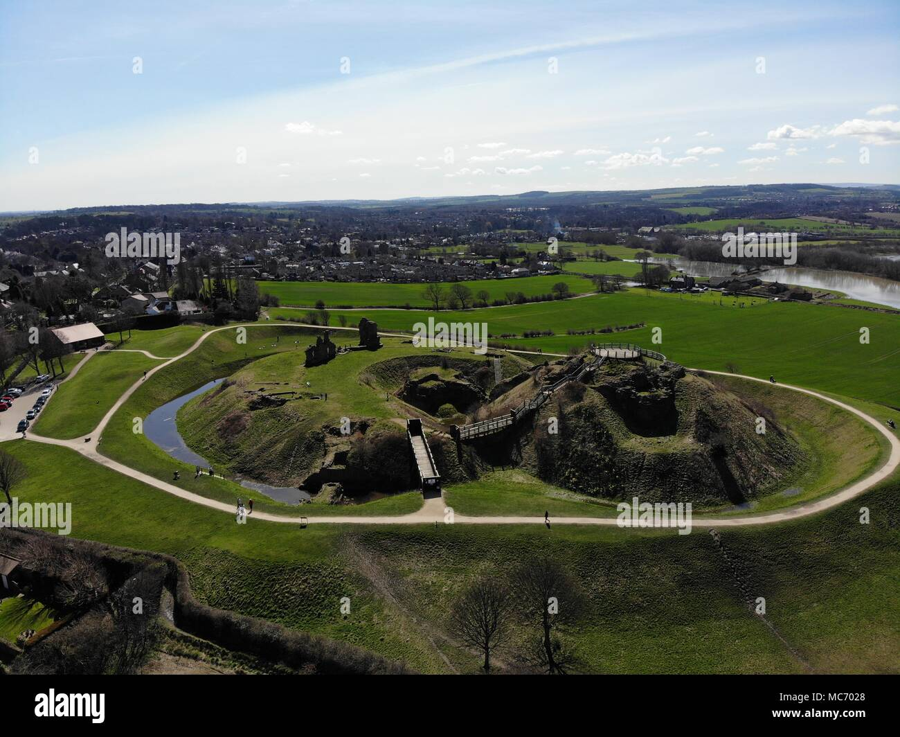 Aerial photos of Sandel Castle in Wakefield in the UK, the ruins of the castle have a moat around the castle grounds, it's also covered in green grass - Stock Image