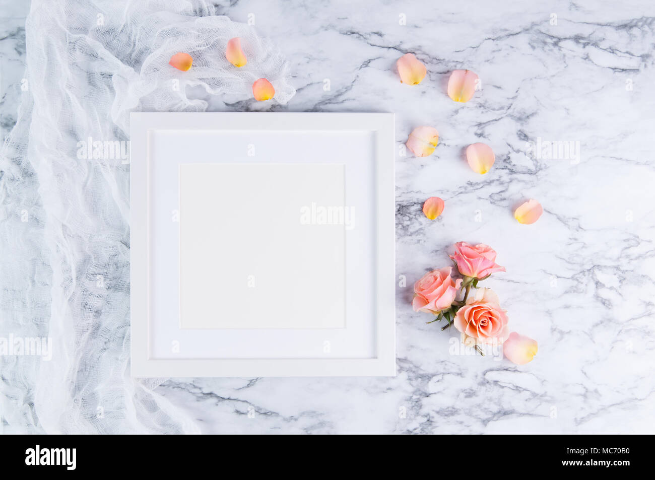 white square frame mockup on a marble background with peach colored ...