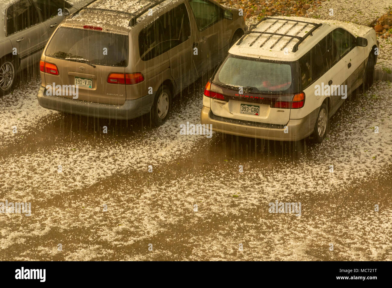 Hail storm. Hail falling on cars and parking area in Aurora Colorado US. - Stock Image
