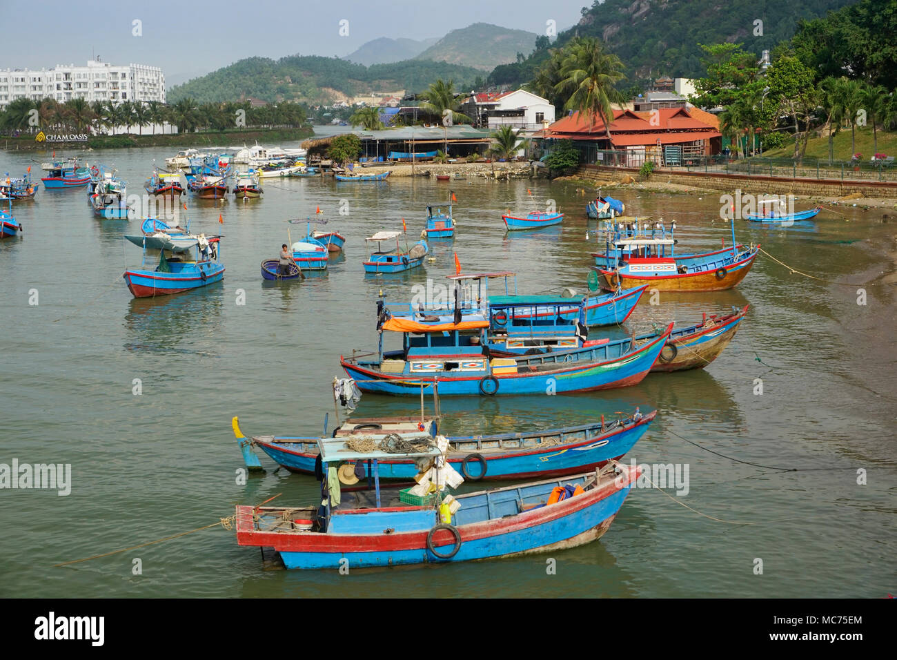 Fishing boats on the Cai River, a Tributary off the South China Sea, Nha Trang, Vietnam - Stock Image