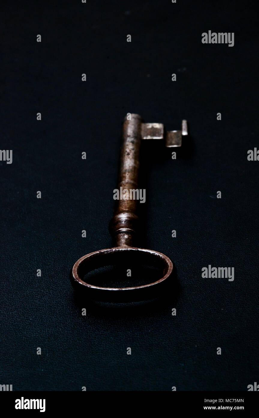 old bit key on a dark background, secrecy concept - Stock Image