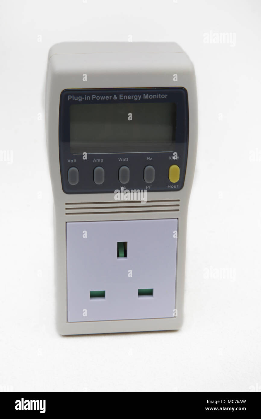 Plug In Mains Power And Energy Monitor - Stock Image