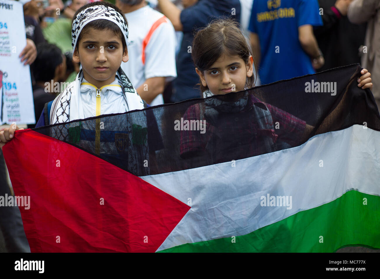 Kuala Lumpur, Malaysia. 13th Apr, 2018. A young protesters hold a Palestinian flag during a rally to commemorate Palestinian Land Day at outside of the US embassy in Kuala Lumpur, Malaysia on April 13, 2018. The protests are being held around the world. Credit: Chris JUNG/Alamy Live News - Stock Image