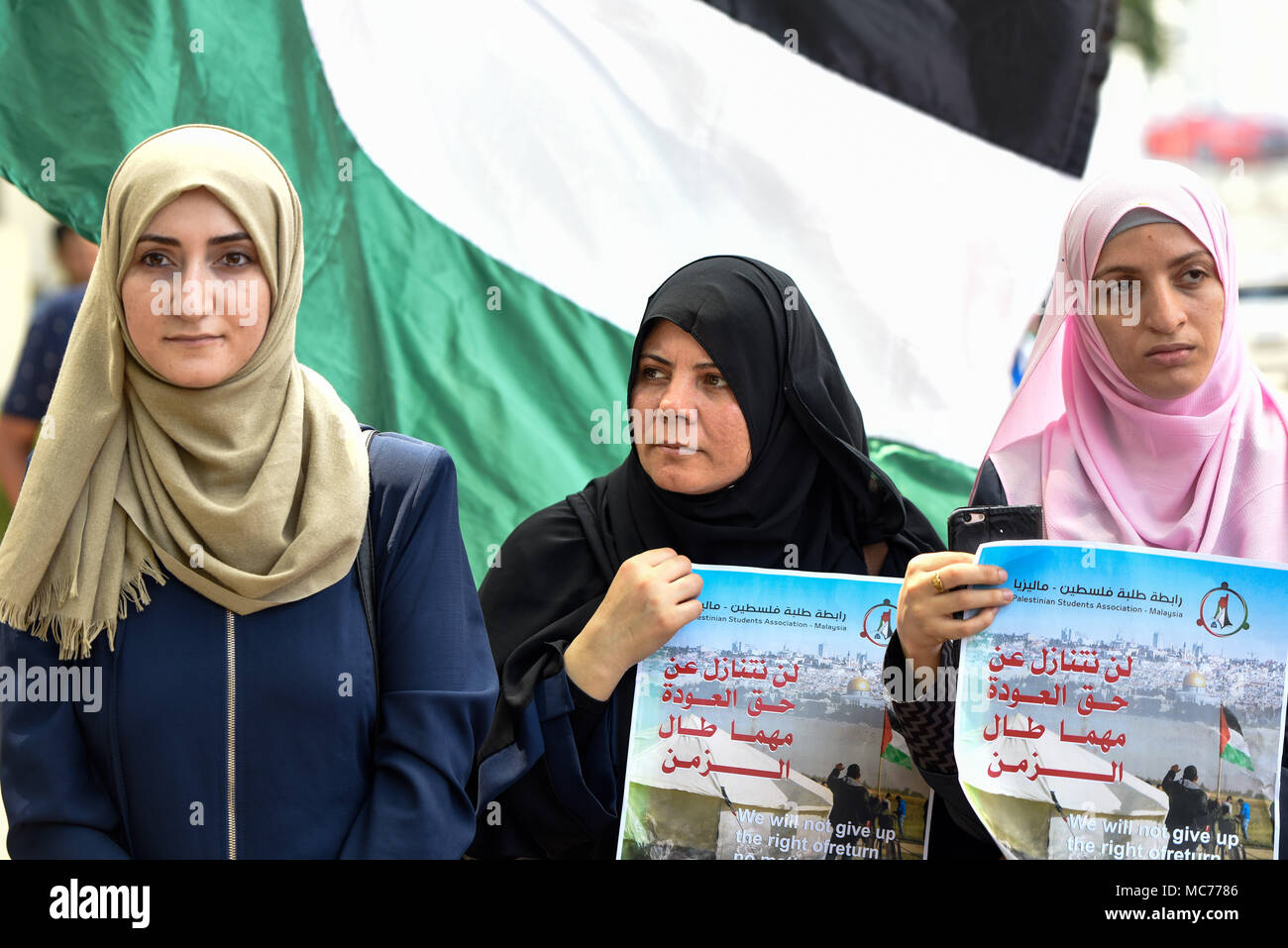 Kuala Lumpur, Malaysia. 13th Apr, 2018. Palestinian protesters march to the US embassy in Kuala Lumpur, Malaysia on April 13, 2018 during a rally of Palestinian Land Day. The protests are being held around the world. Credit: Chris JUNG/Alamy Live News - Stock Image
