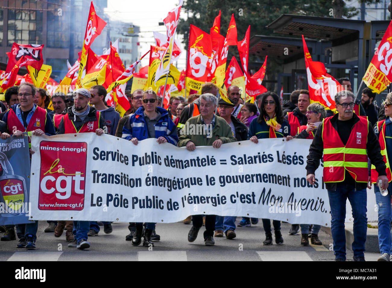 Lyon, France, 13th April 2018: Called by trade unions, SNCF employees are seen in Lyon (Central-Eastern France) on April 13, 2018 as they march in Part-Dieu area on the fifth day of action against status reform engaged by French Government.  Credit: Serge Mouraret/Alamy Live News - Stock Image