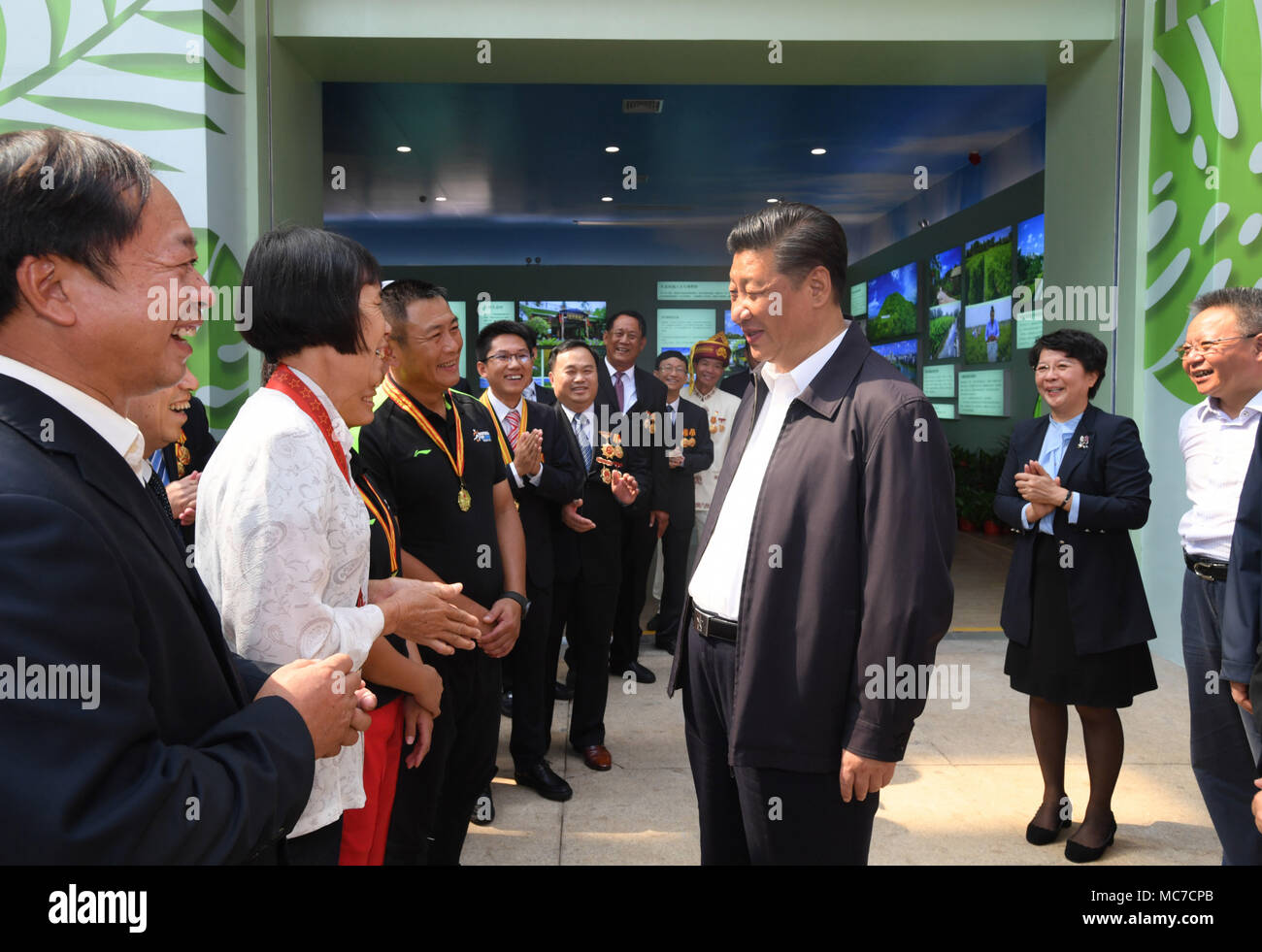 Haikou, China's Hainan Province. 13th Apr, 2018. Chinese President Xi Jinping, also general secretary of the Communist Party of China Central Committee and chairman of the Central Military Commission, talks with model workers and representatives of different occupations at a plaza of the Hainan Museum in Haikou, south China's Hainan Province, April 13, 2018. Xi made an inspection tour in Hainan from Wednesday to Friday. Credit: Li Xueren/Xinhua/Alamy Live News Stock Photo