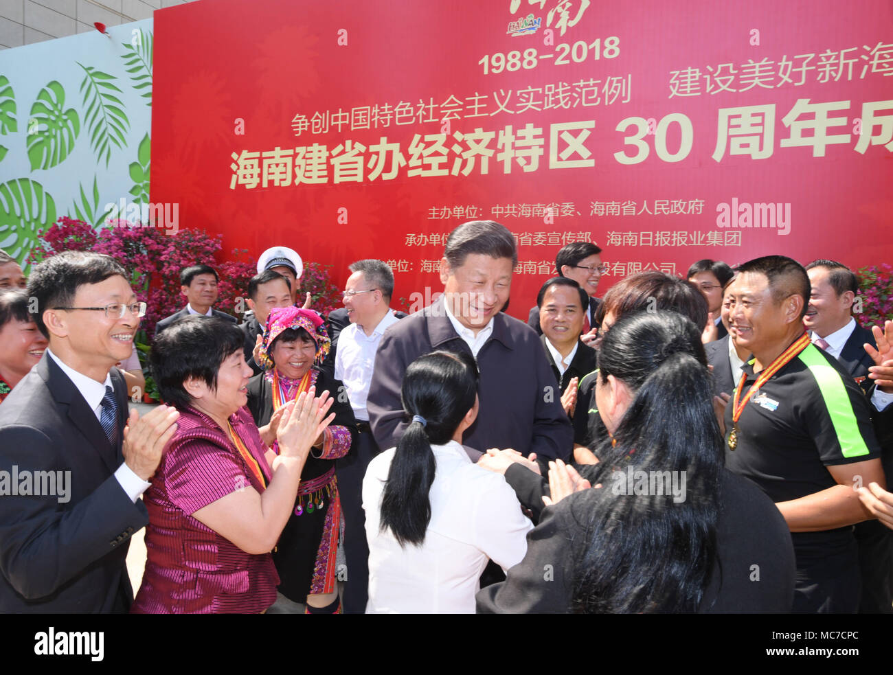 Haikou, China's Hainan Province. 13th Apr, 2018. Chinese President Xi Jinping, also general secretary of the Communist Party of China Central Committee and chairman of the Central Military Commission, shakes hands with model workers and representatives of different occupations at a plaza of the Hainan Museum in Haikou, south China's Hainan Province, April 13, 2018. Xi made an inspection tour in Hainan from Wednesday to Friday. Credit: Li Xueren/Xinhua/Alamy Live News Stock Photo