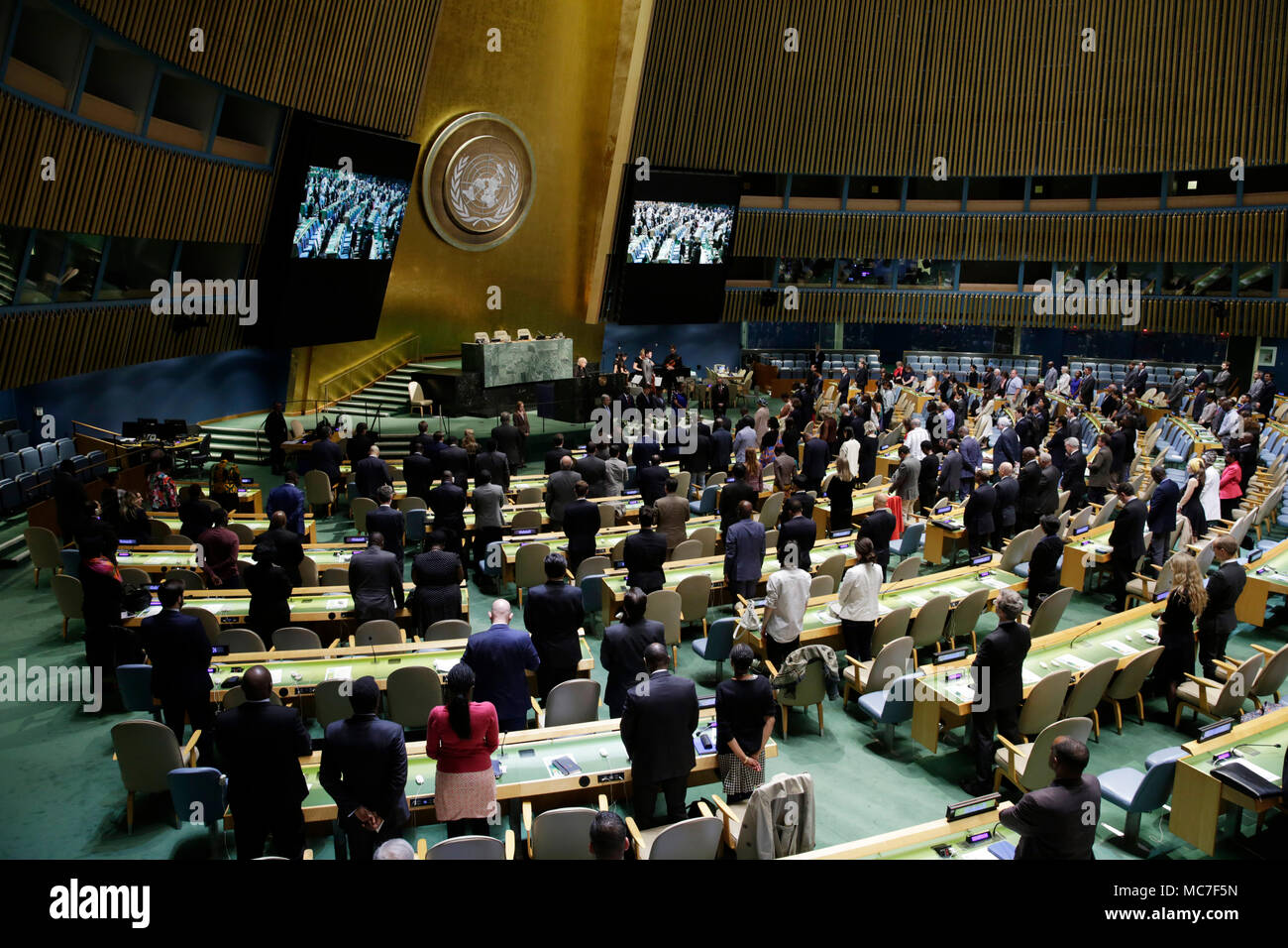 New York, USA, 13 April 2018. People observe a minute of silence during an event to commemorate the international day of reflection on the Rwanda genocide, at the United Nations headquarters in New York, April 13, 2018. Credit: Xinhua/Alamy Live News - Stock Image