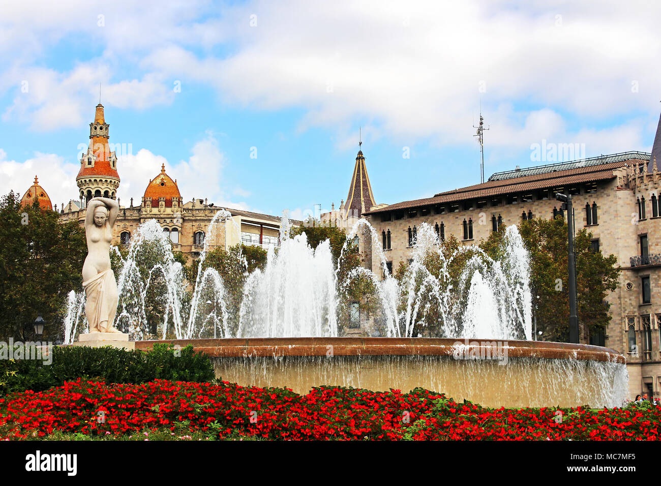 Fountain at Catalonia Square in Barcelona, Spain. Some of most important streets and avenues meet at here. Center of business and cultural life - Stock Image