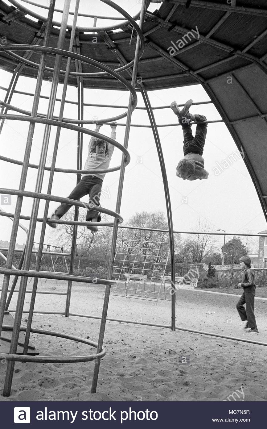 Looking Back: Remembering when slides were a key part a Bolton childhood Three-young-boys-in-darley-street-park-bolton-lancashire-north-west-england-uk-in-the-1970s-two-of-them-are-playing-on-a-covered-climbing-frame-photo-don-tonge-photographer-MC7N5R