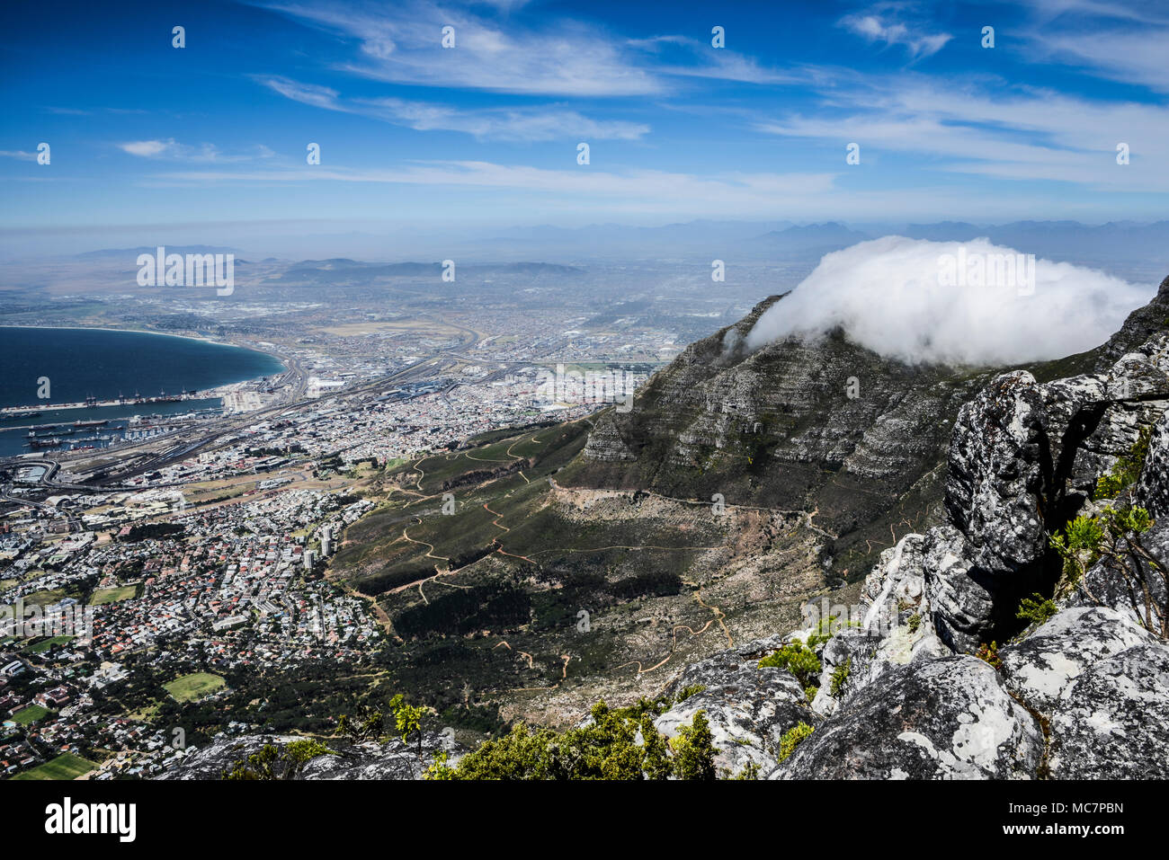 Cloud sitting on top of Devil's Peak seen from Table Mountain, Cape Town, South Africa - Stock Image