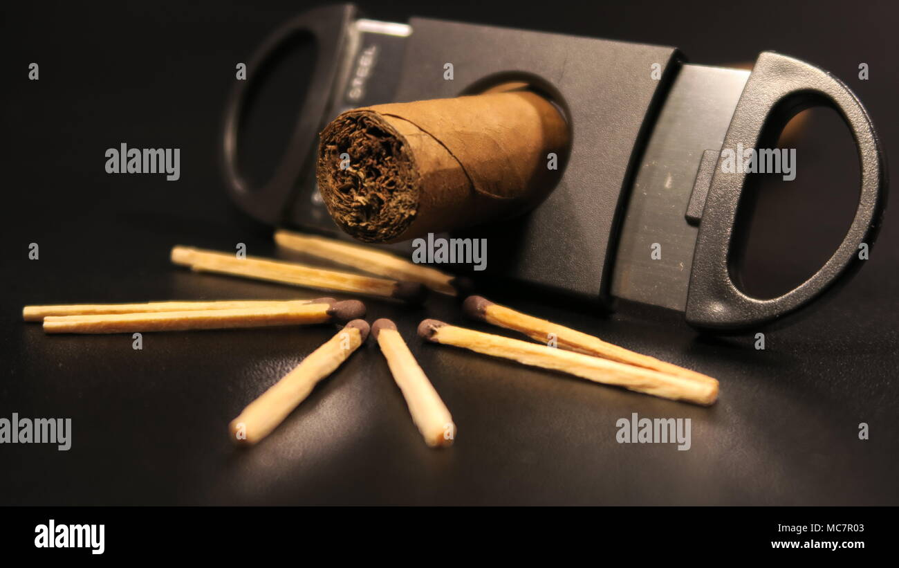 Cuban Cigar and cutter on a Black background - Stock Image