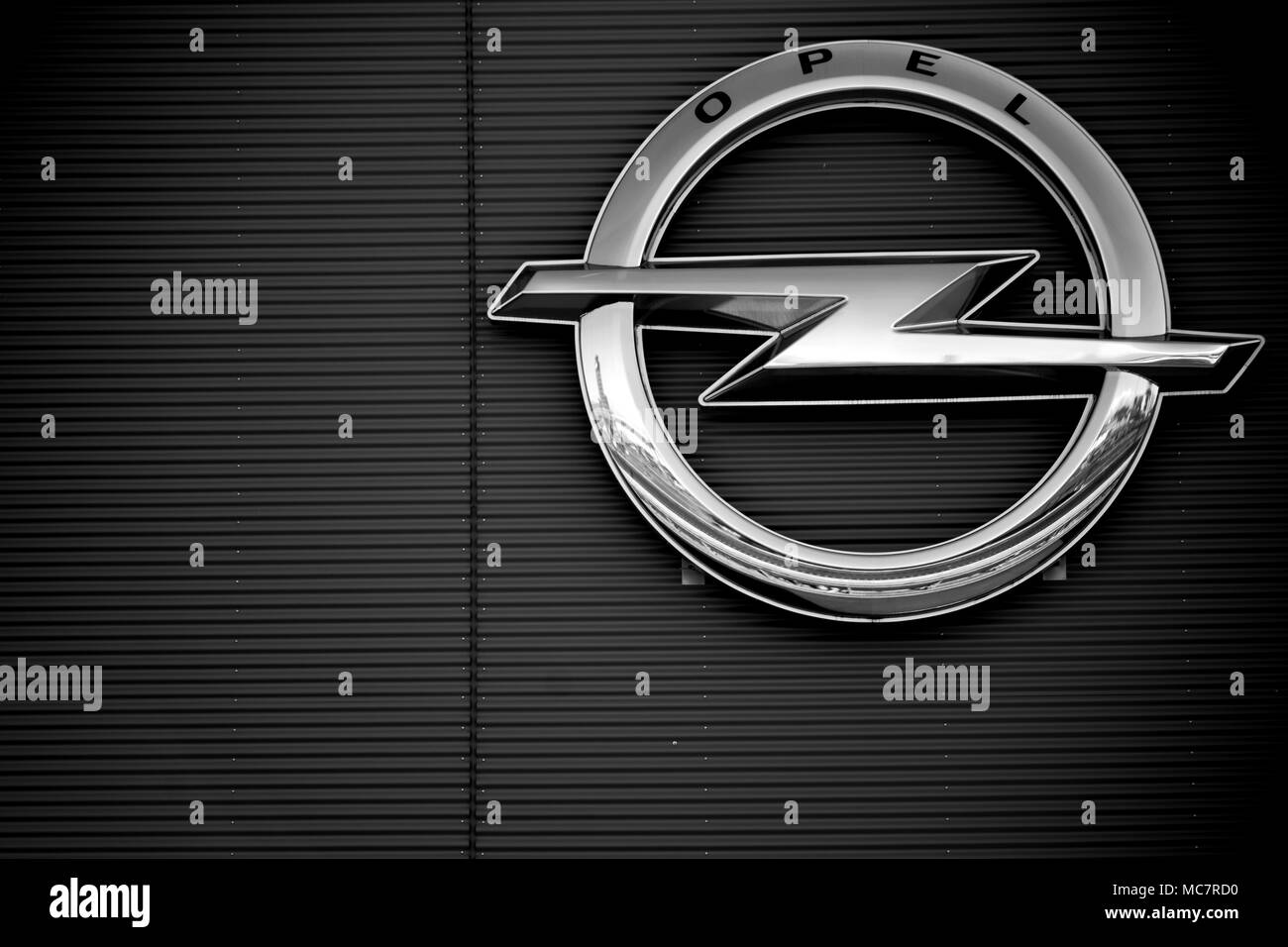 Ruesselsheim, Germany - April 11, 2018: The symbol and glossy logo of the Opel Group on the facade of an industrial building of Opel Factory on April  - Stock Image