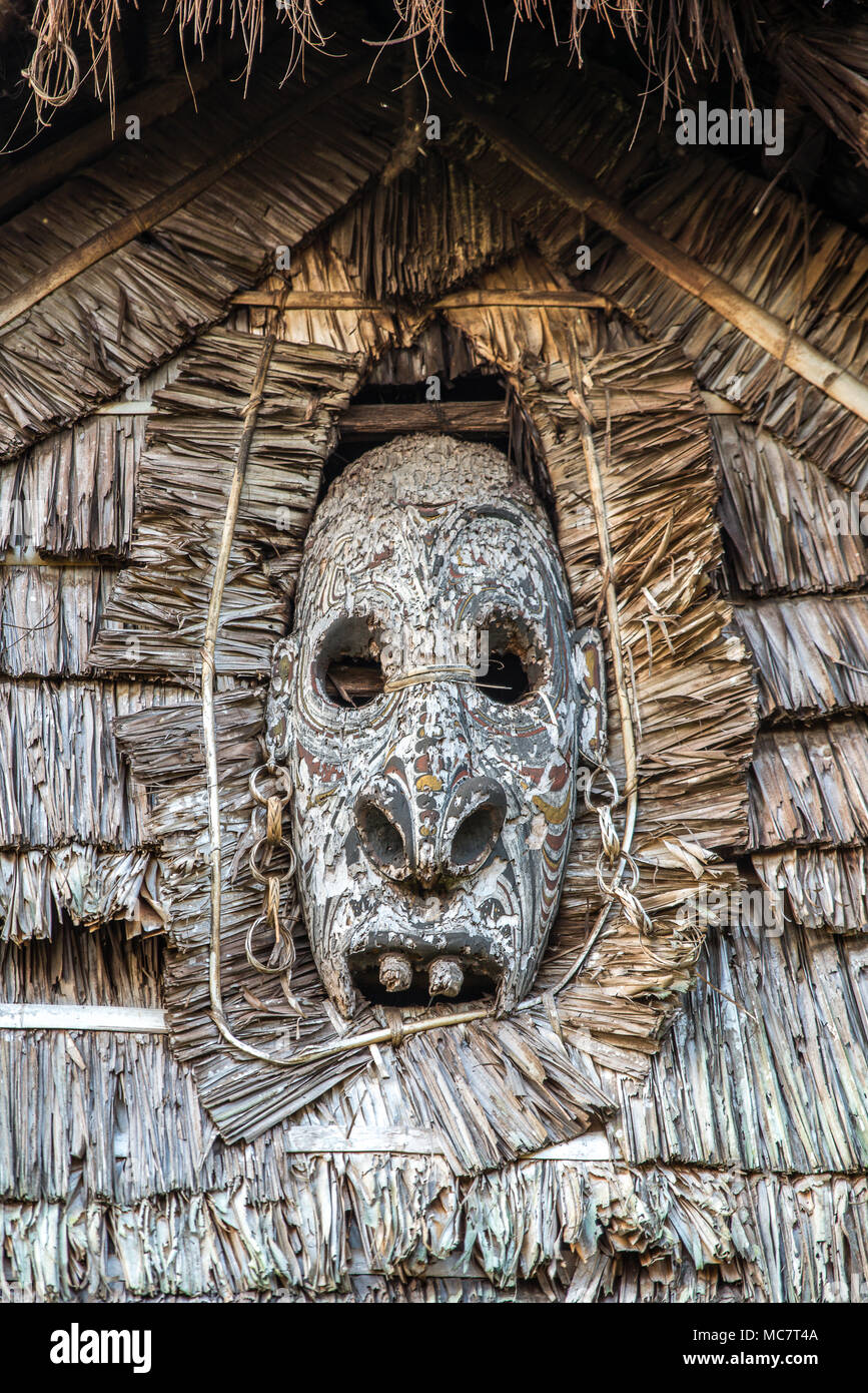 A wood carved mask Haus Tambaran (men's or spirits house) of Kaminibit village, East Sepik Province, Papua New Guinea Stock Photo