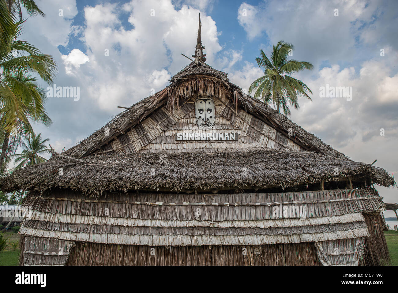 Detail of a wooden masked on the roof of a Haus Tambaran, Korogo Village, Middle Sepik, Papua New Guinea Stock Photo