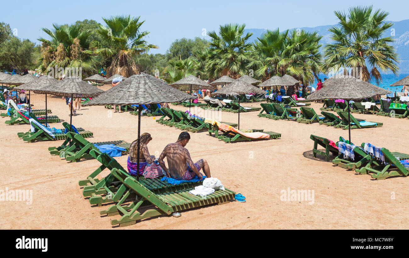 Green chaise lounges on the Turkish Sideyri island, 16 AUG, 2017 - Stock Image