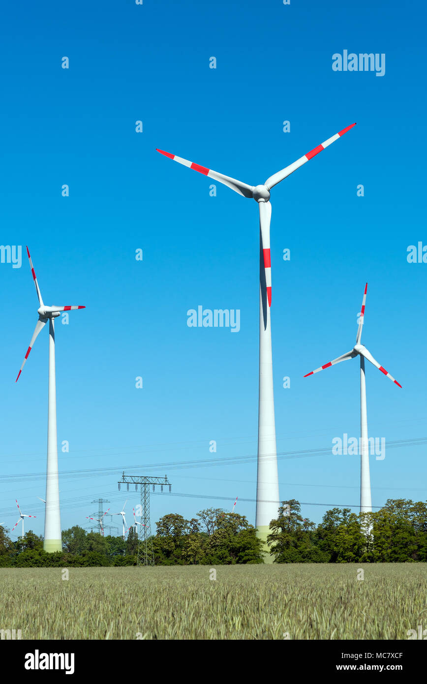 Modern wind engines on a sunny day seen in Germany Stock Photo