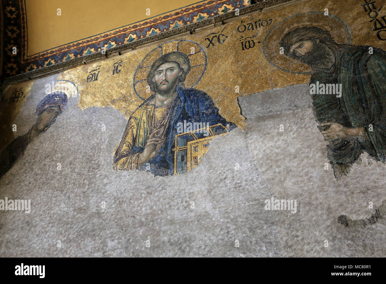 The Deësis mosaic, ancient Christian art showing Christ, Virgin Mary and John the Baptist, on the upper gallery inside Hagia Sophia in Istanbul Stock Photo