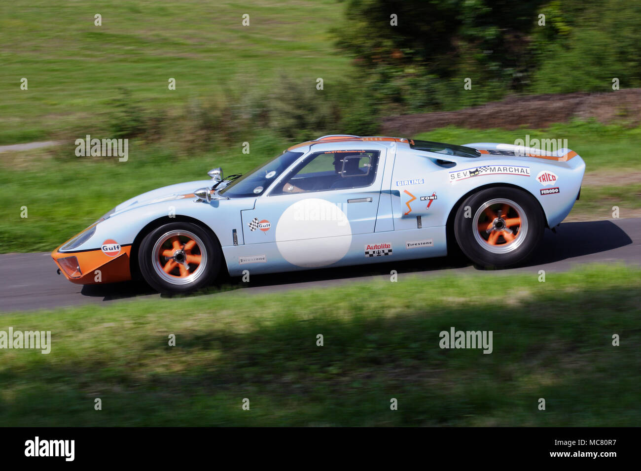 Gulf Colours Ford Gt Classic Vintage Racing Car Driving Fast In Profile Side View