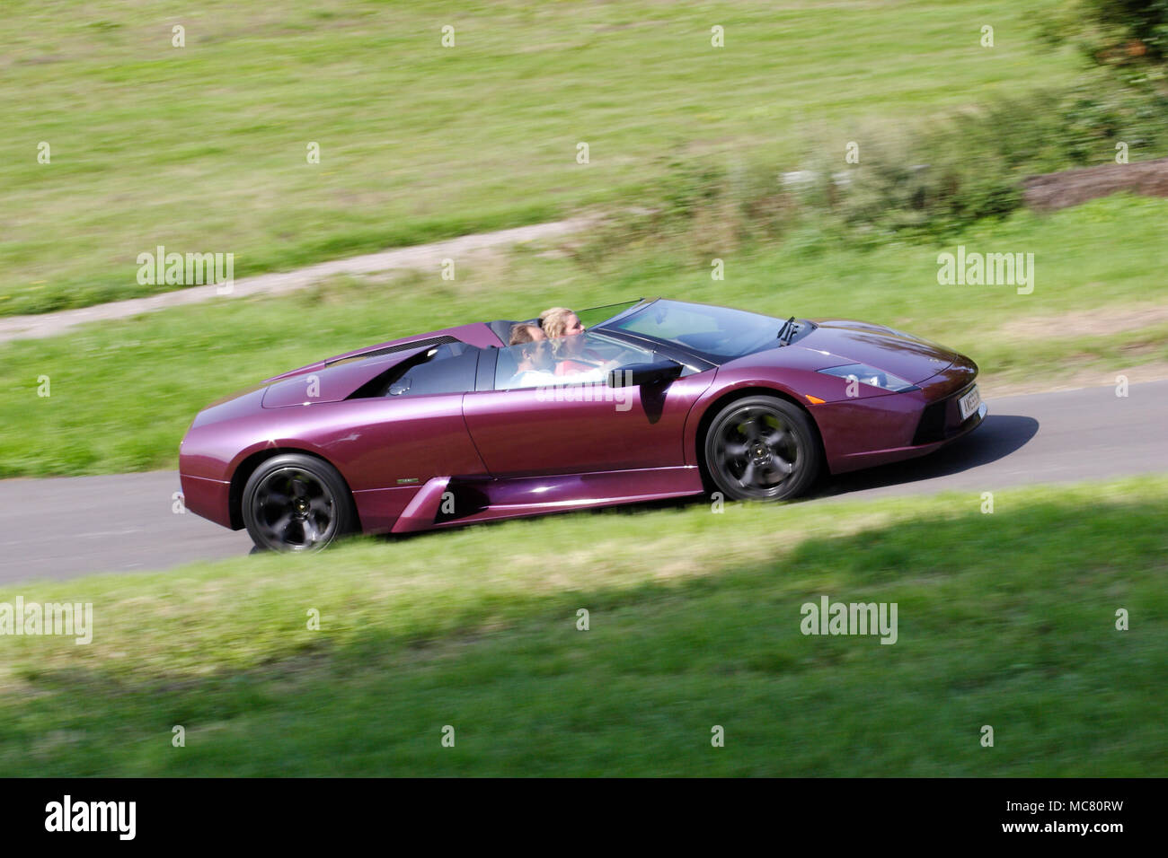 Profile Side View Of A Purple Lamborghini Murcielago Roadster
