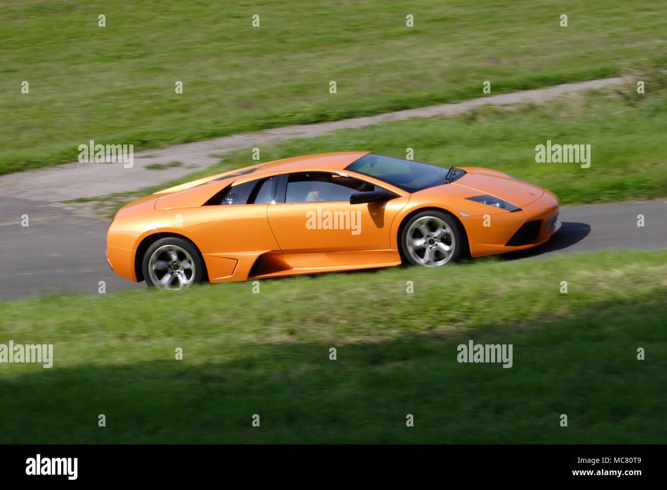 Orange Lamborghini Murcielago Driving Fast   Stock Image