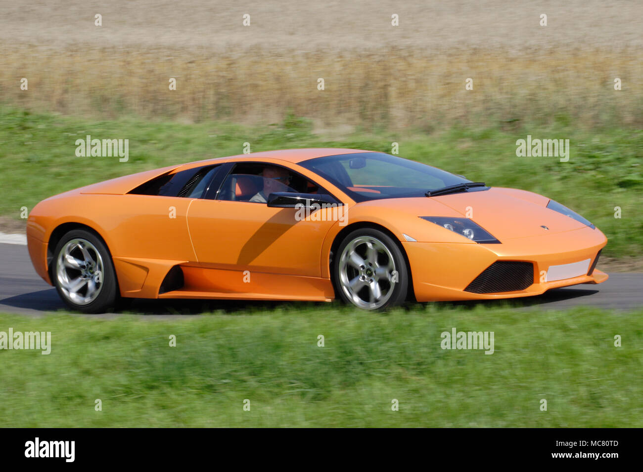 Orange Lamborghini Murcielago Driving Fast Stock Photo 179655853