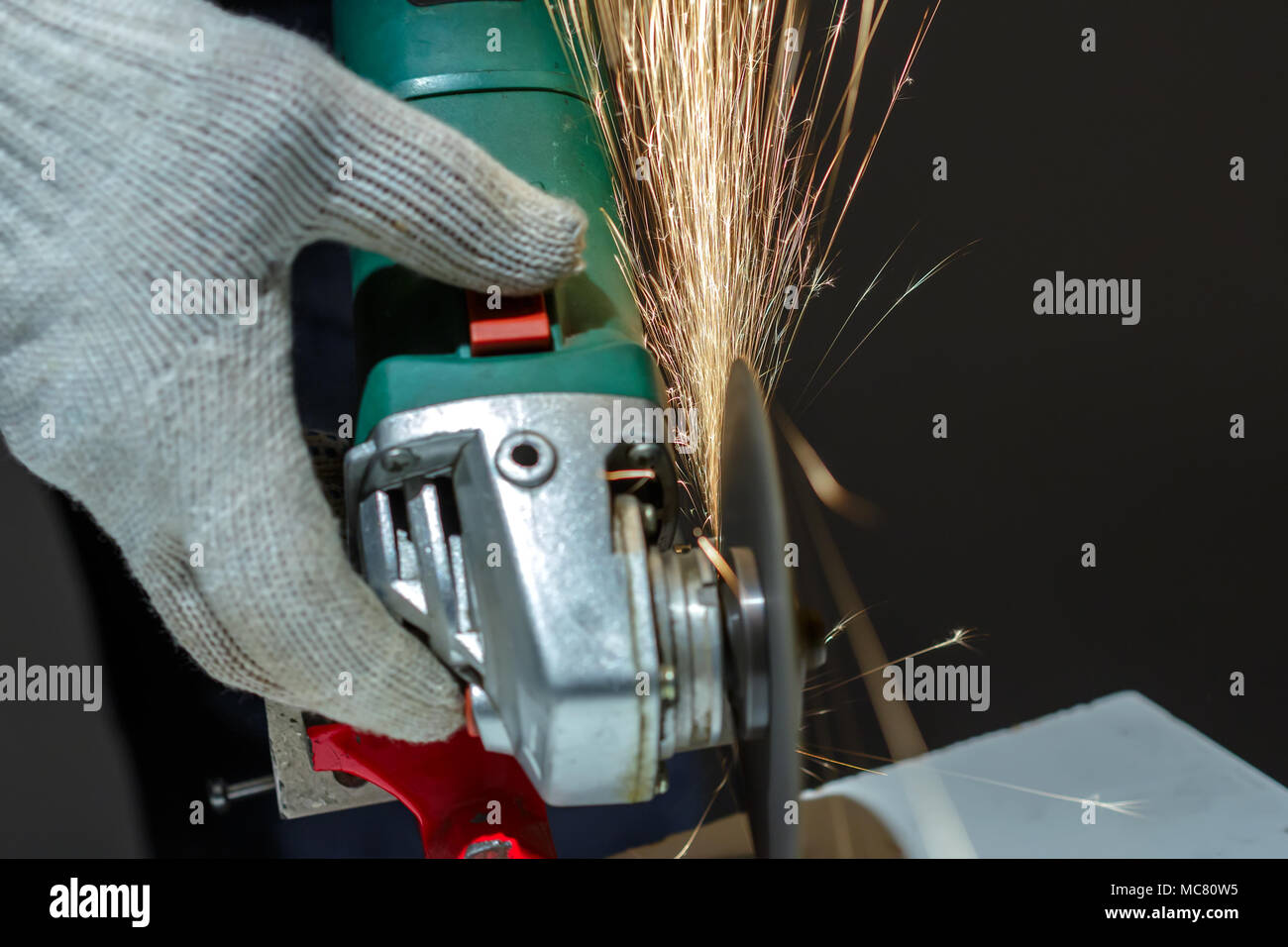 Angle grinder make a flash sparks - Stock Image