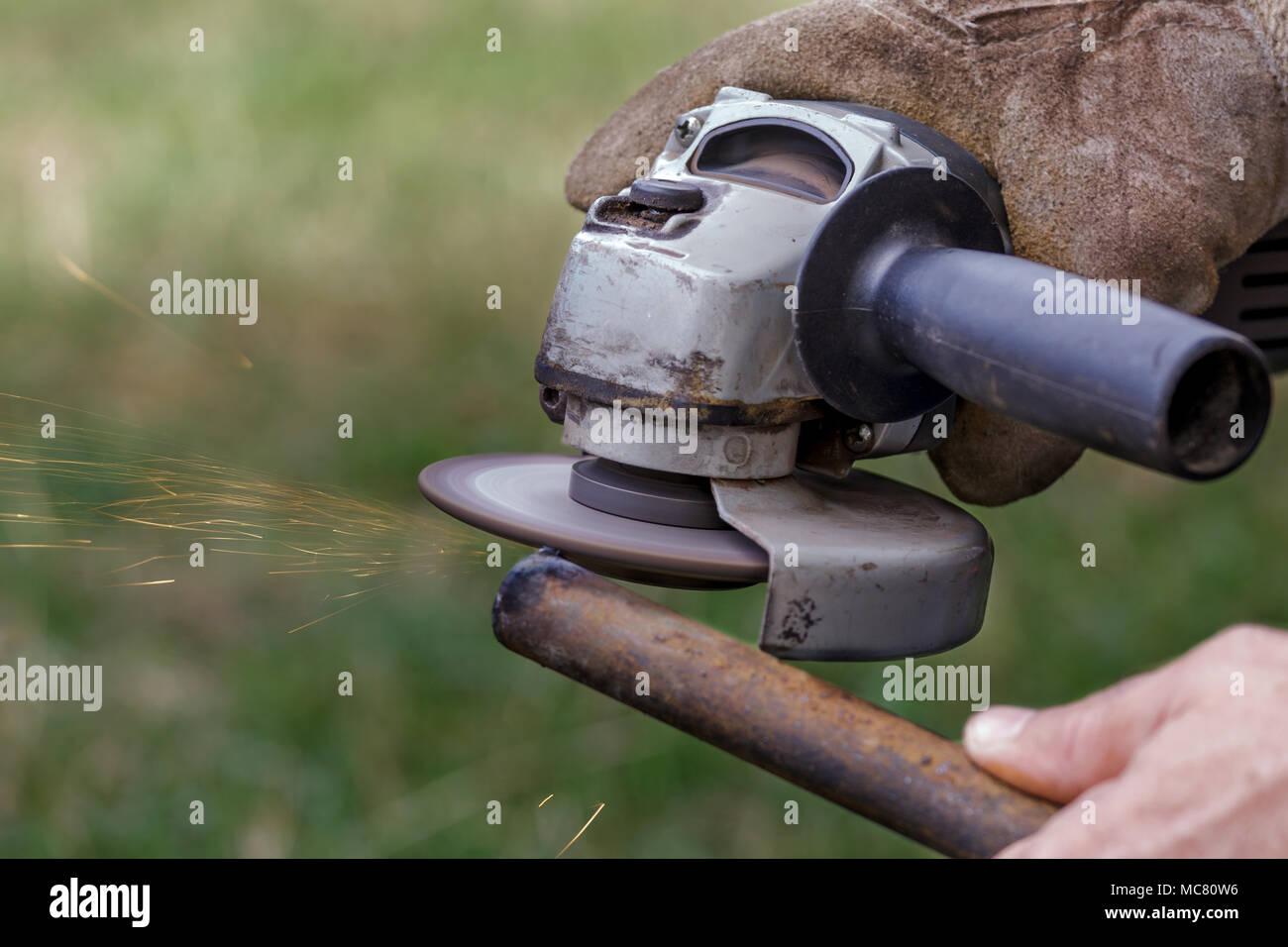 Angle grinder make a flash sparks - Stock Image