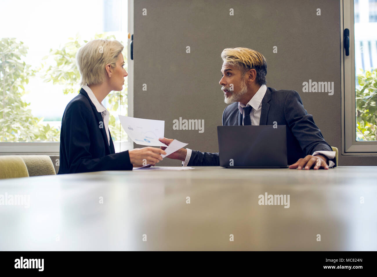 Man and woman meeting in office - Stock Image
