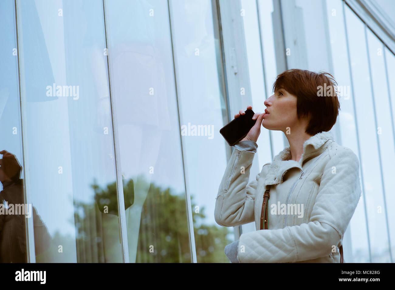 Woman window shopping - Stock Image